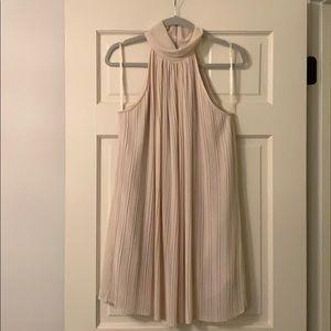 Vestique pleated dress.
